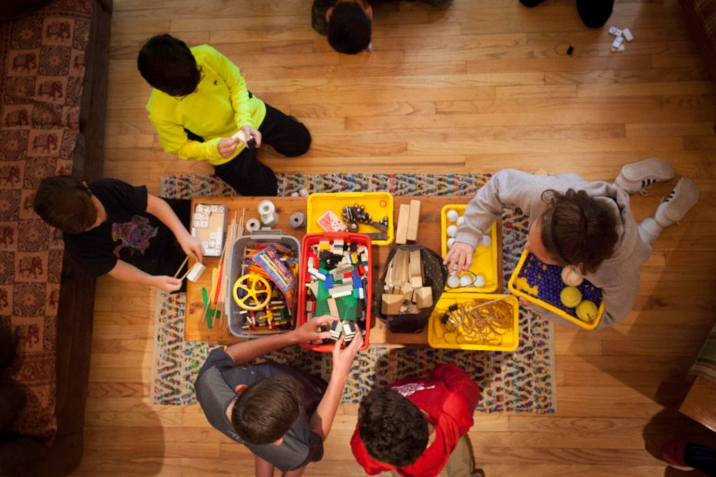 Kids playing with Rube Goldberg objects